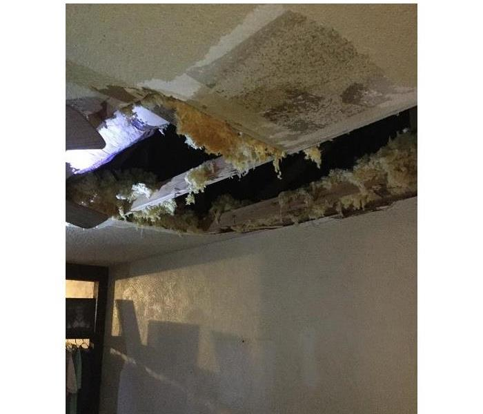 Water Damage Attic- placed HVAC malfunction brings the ceiling down